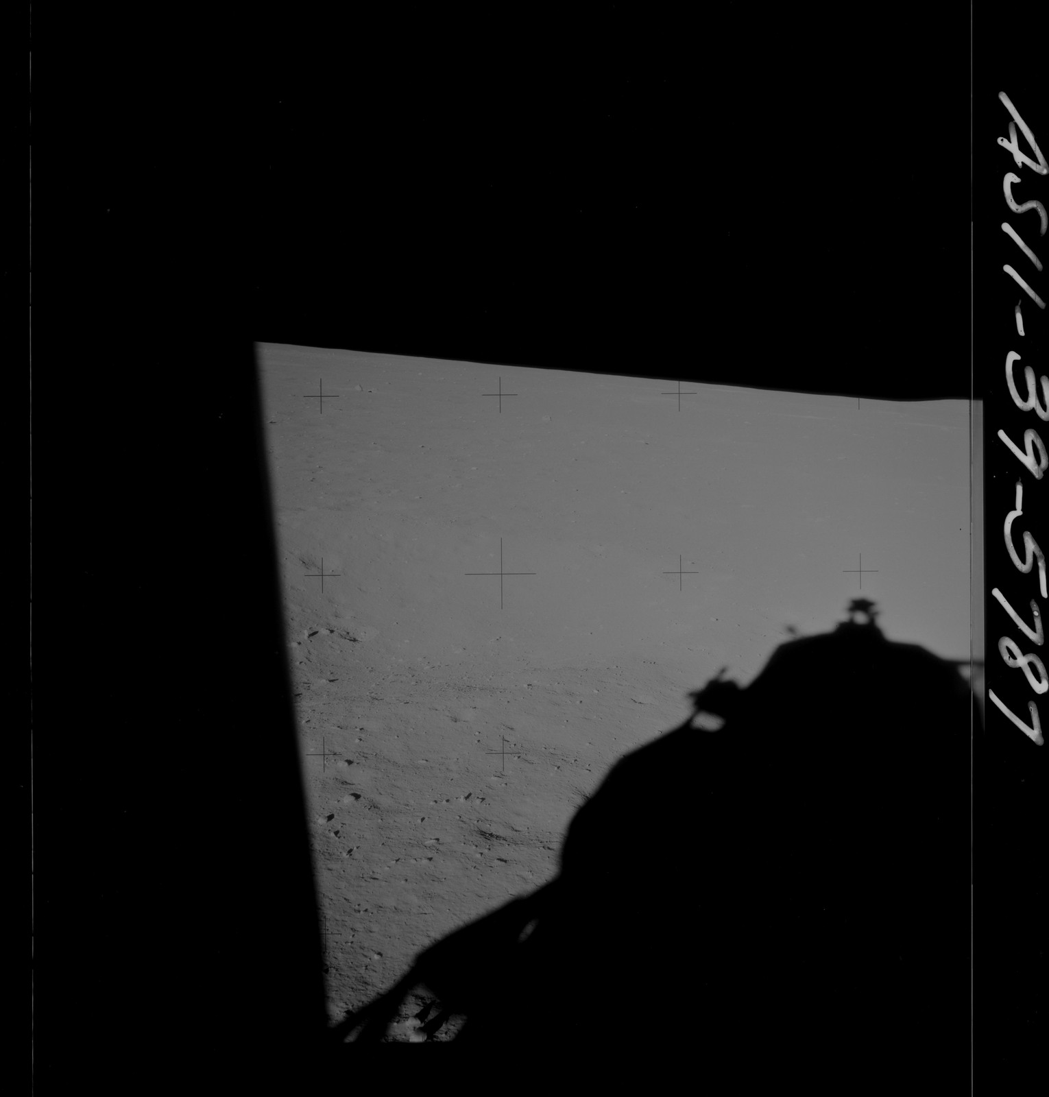 AS11-39-5787 - Apollo 11 - Apollo 11 Mission image - Shadow of Lunar Module on lunar surface