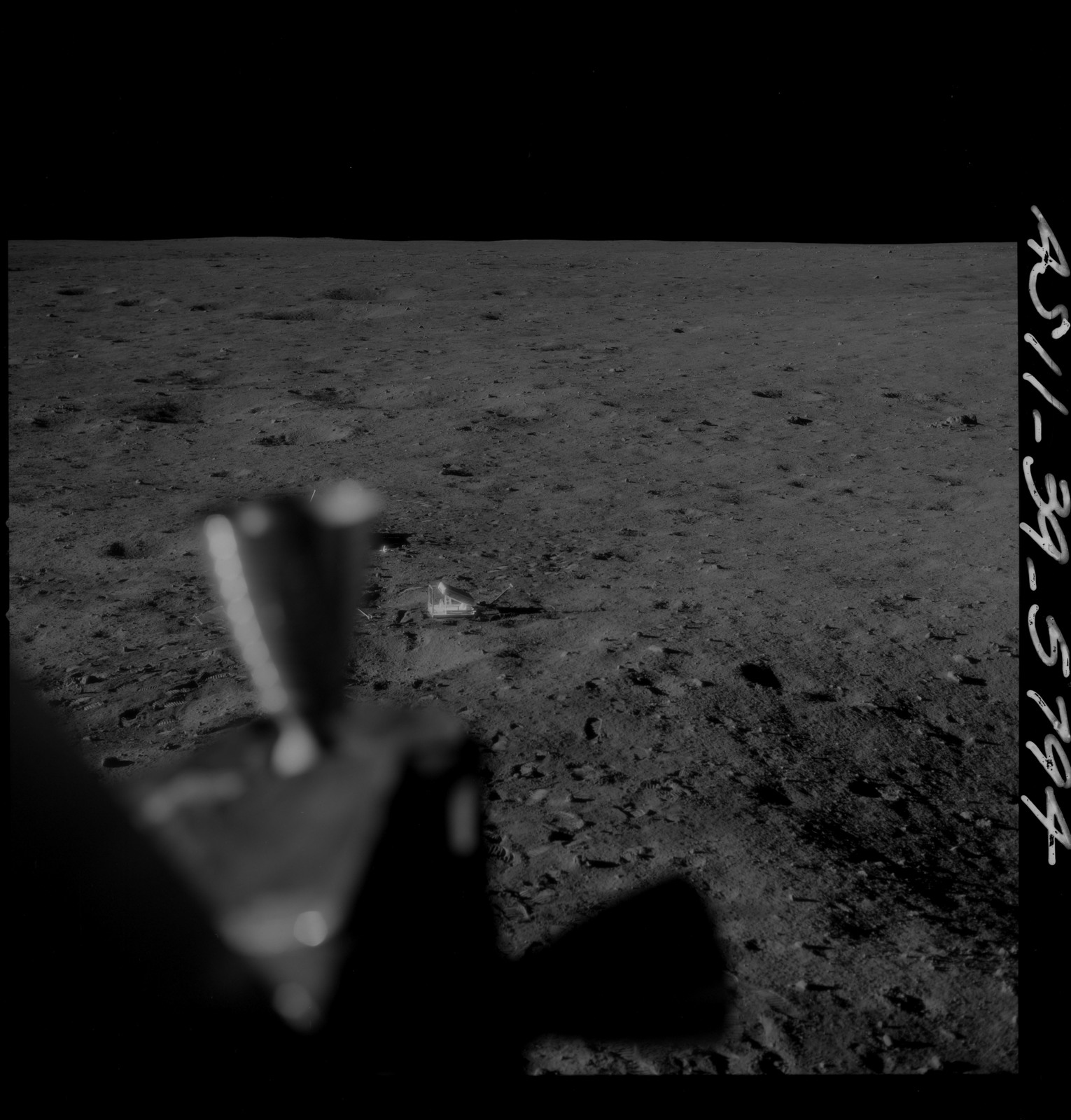 AS11-39-5794 - Apollo 11 - Apollo 11 Mission image - Lunar module thrusters with lunar surface in background
