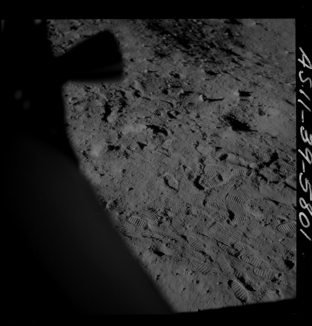 AS11-39-5801 - Apollo 11 - Apollo 11 Mission image - Shadow of Lunar Module thruster on lunar surface
