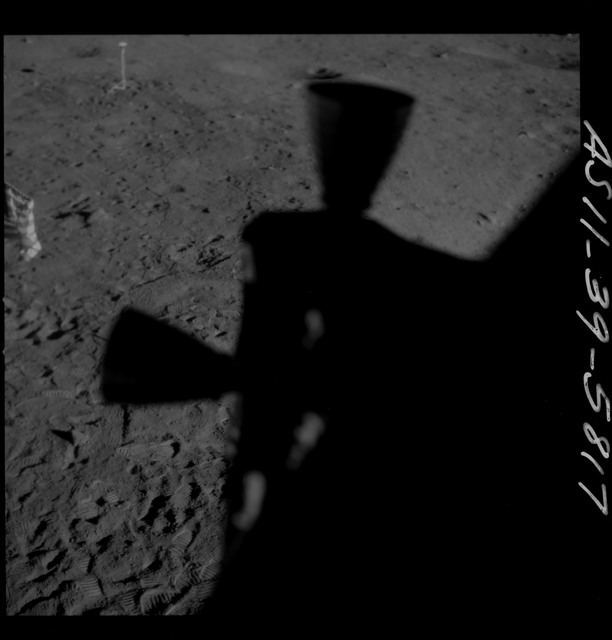 AS11-39-5817 - Apollo 11 - Apollo 11 Mission image - Shadow of Lunar Module thrusters visible on lunar surface