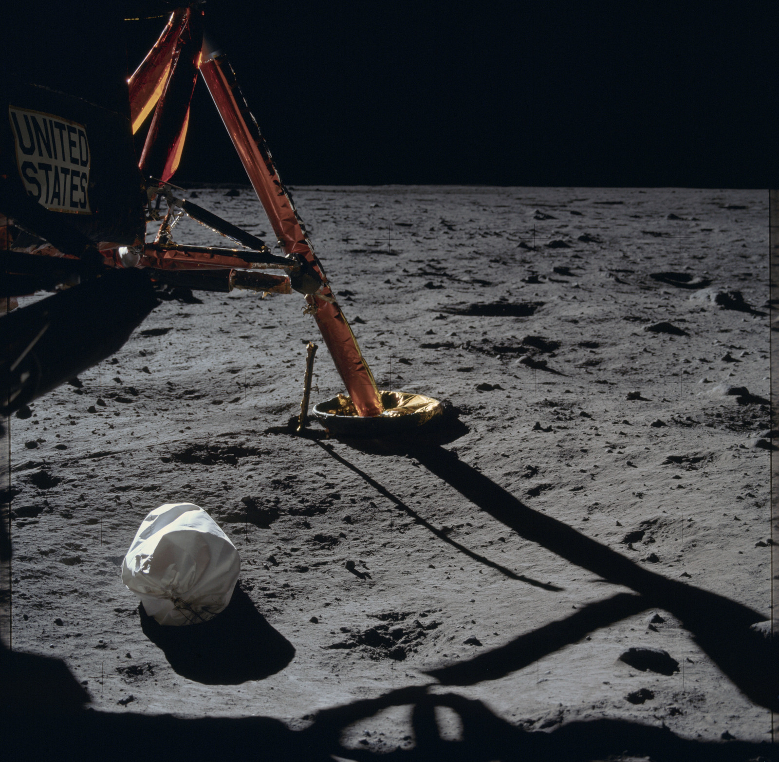 AS11-40-5850 - Apollo 11 - Apollo 11 Mission image - View of the lunar surface and Lunar Module at Tranquility Base