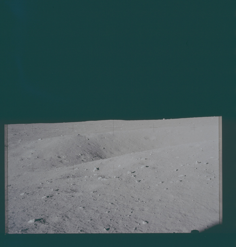AS11-40-5853 - Apollo 11 - Apollo 11 Mission image - View of the lunar surface, horizon and LRL 10046 from Tranquility Base