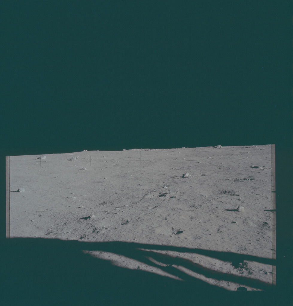 AS11-40-5856 - Apollo 11 - Apollo 11 Mission image - View of the lunar surface and horizon from Tranquility Base