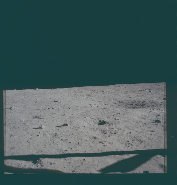 AS11-40-5857 - Apollo 11 - Apollo 11 Mission image - View of the lunar surface and horizon from Tranquility Base