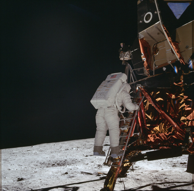 AS11-40-5867 - Apollo 11 - Apollo 11 Mission image - Astronaut Edwin Aldrin descends the Lunar Module ladder