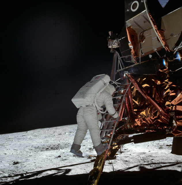 AS11-40-5868 - Apollo 11 - Apollo 11 Mission image - Astronaut Edwin Aldrin descends the Lunar Module ladder