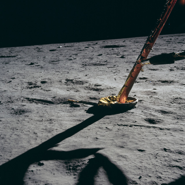 AS11-40-5870 - Apollo 11 - Apollo 11 Mission image - Lunar Module strut and footpad on the surface of the moon