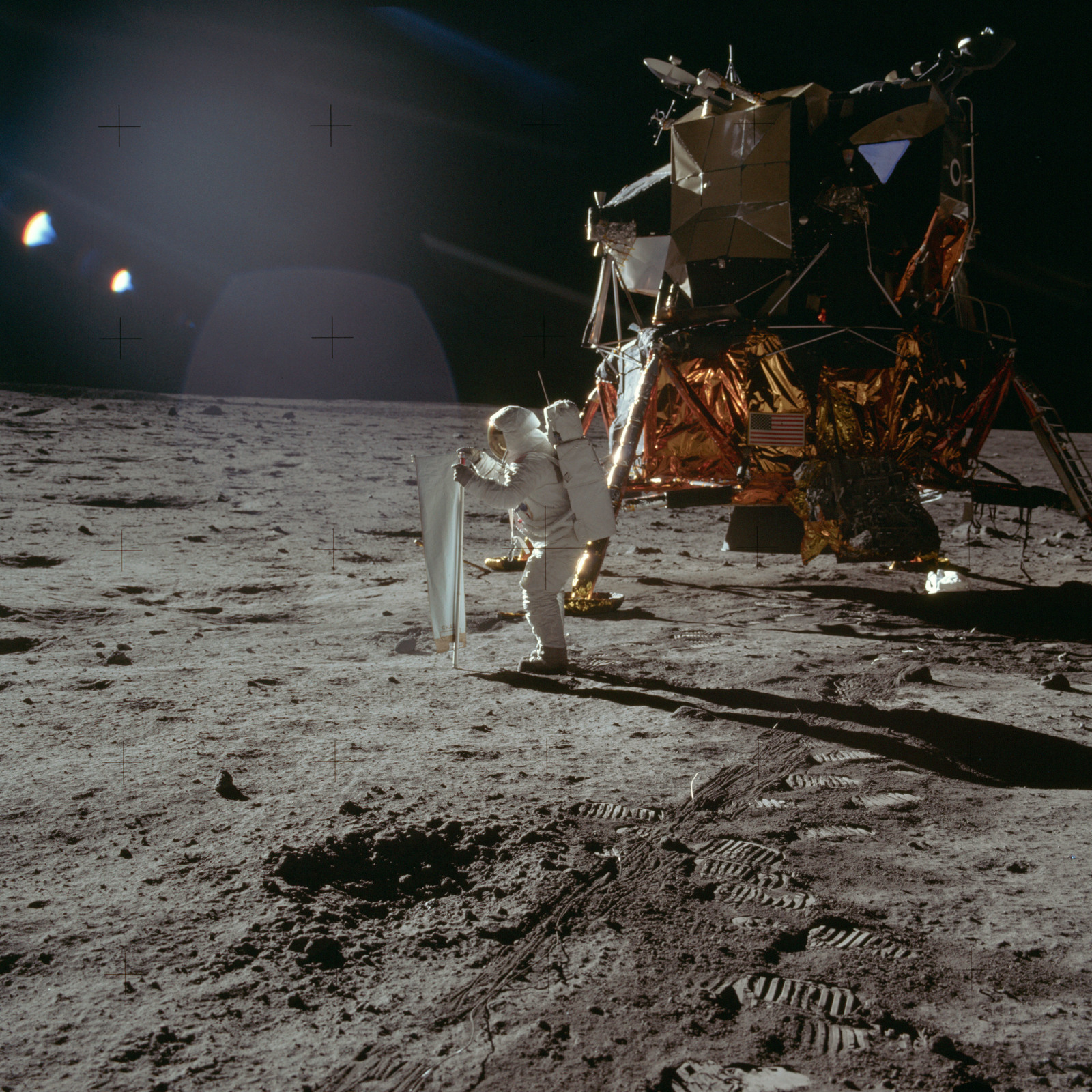AS11-40-5872 - Apollo 11 - Apollo 11 Mission image - Astronaut Edwin Aldrin sets up the SWC experiment on the lunar surface