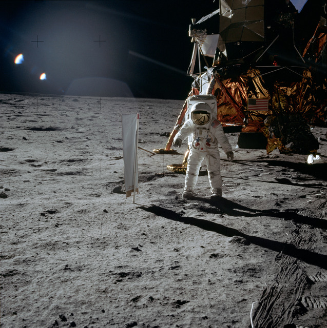 AS11-40-5873 - Apollo 11 - Apollo 11 Mission image - Astronaut Edwin Aldrin stands beside the SWC experiment on the lunar surface