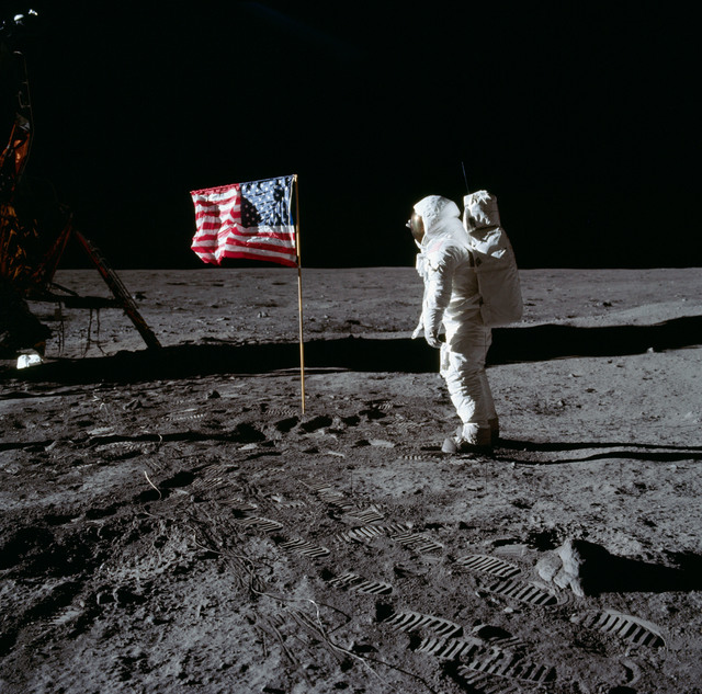 AS11-40-5874 - Apollo 11 - Apollo 11 Mission image - Astronaut Edwin Aldrin poses beside the U.S. flag that has been placed on the moon