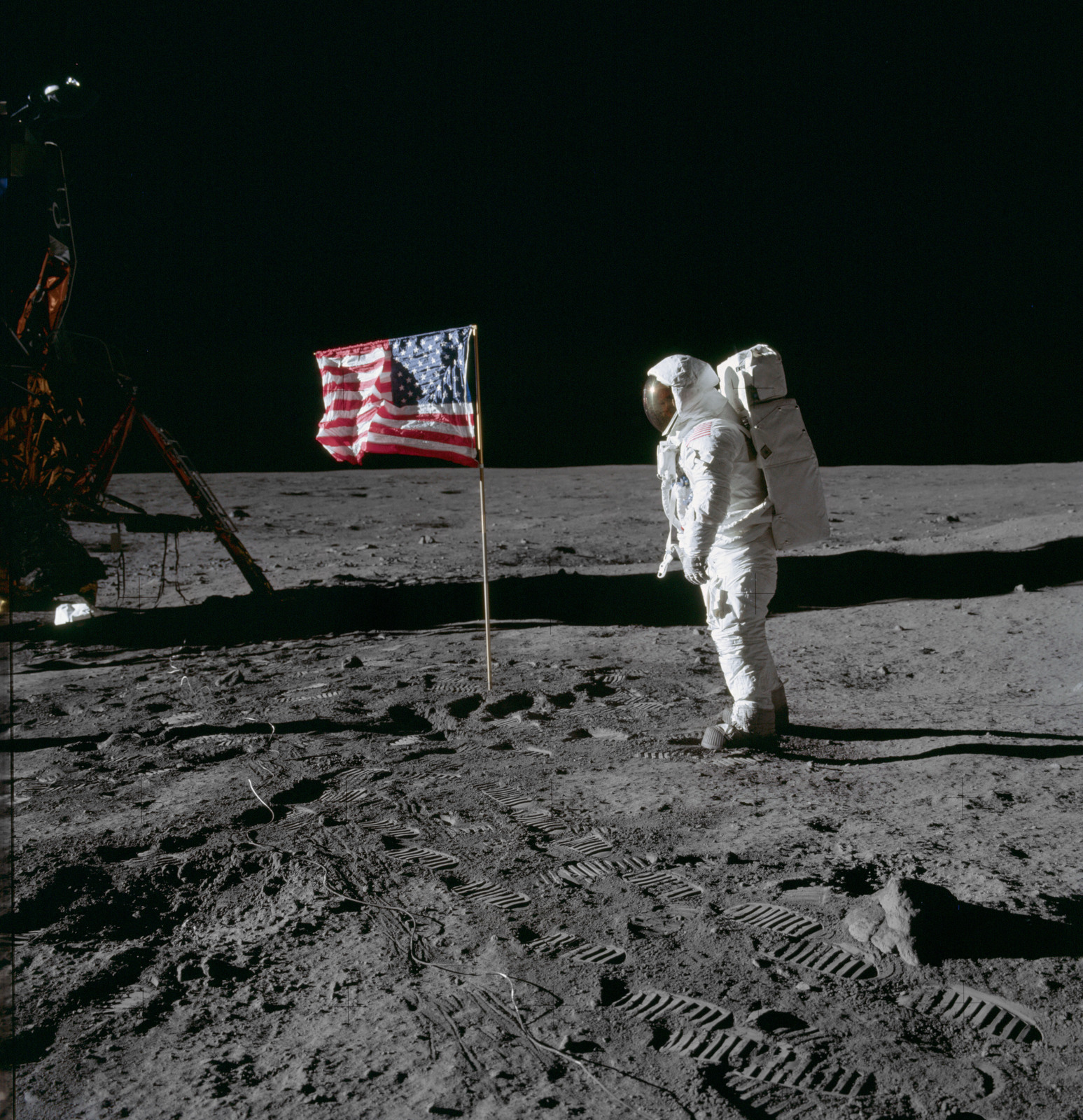 AS11-40-5875 - Apollo 11 - Apollo 11 Mission image - Astronaut Edwin Aldrin salutes the U.S. flag that has been placed on the moon