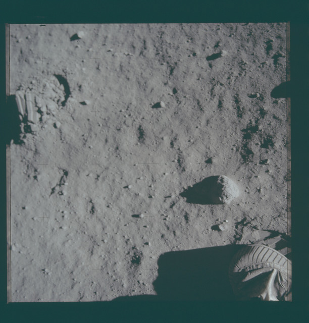 AS11-40-5879 - Apollo 11 - Apollo 11 Mission image - Lunar surface with Astronaut boot in field of view