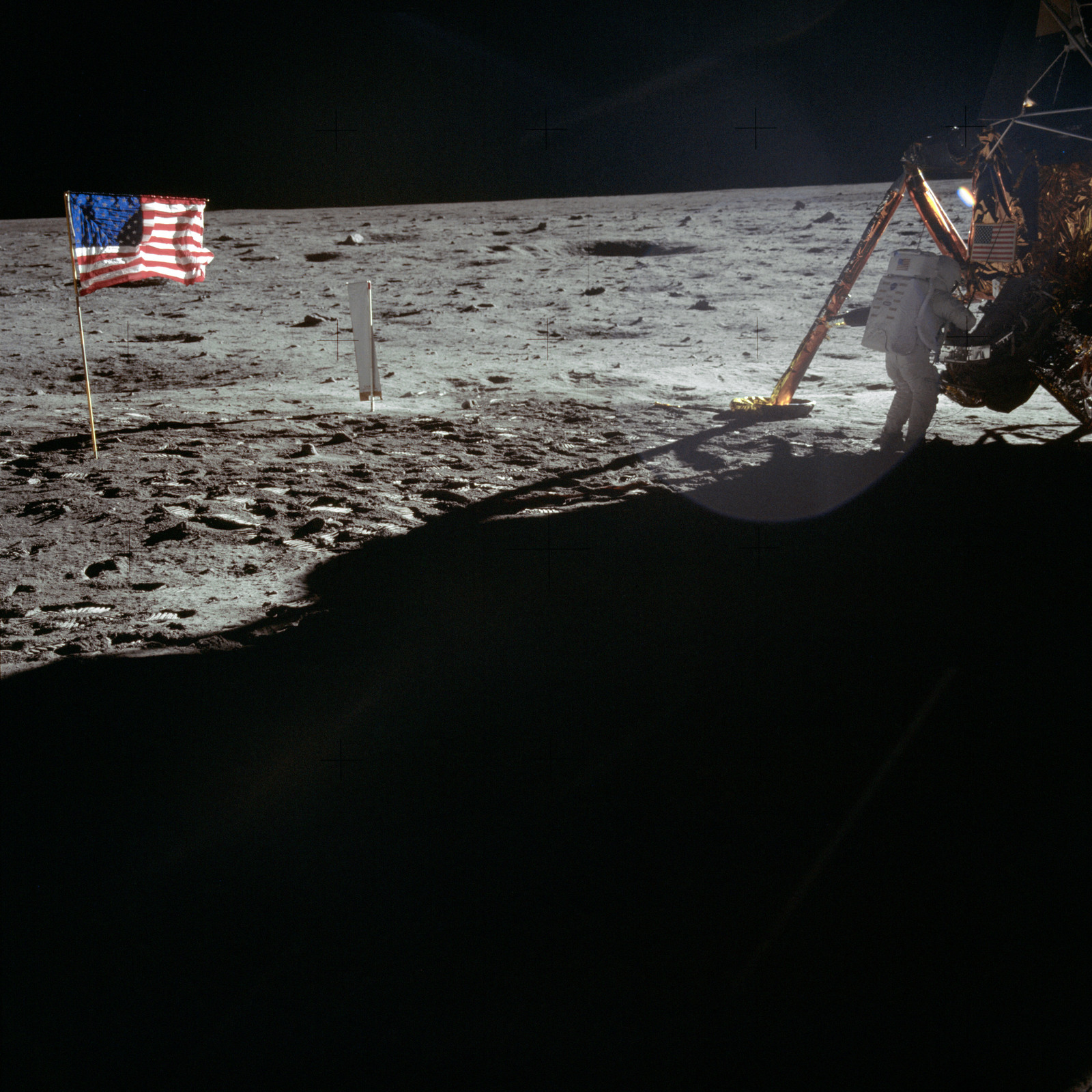 AS11-40-5886 - Apollo 11 - Apollo 11 Mission image - Astronaut Neil Armstrong works at the Lunar Module