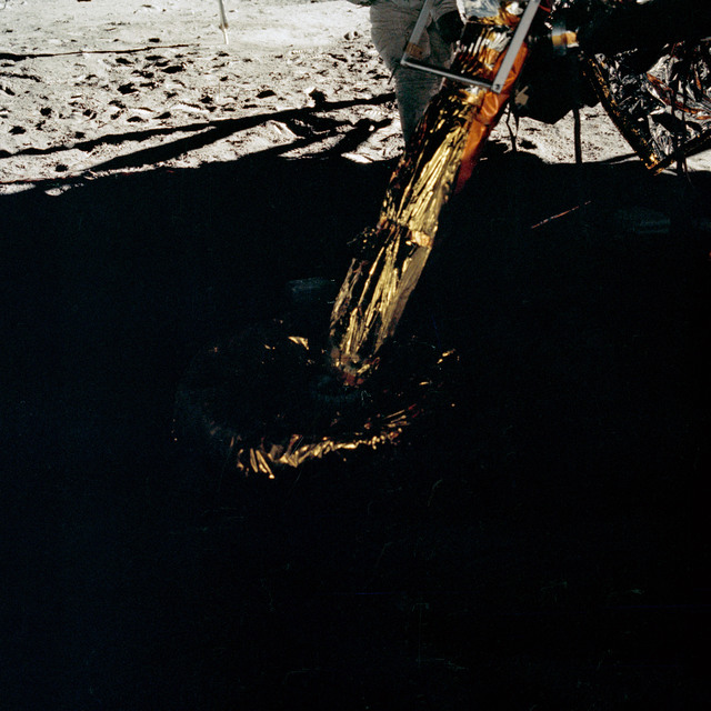 AS11-40-5895 - Apollo 11 - Apollo 11 Mission image -  View of Lunar Module strut and footpad