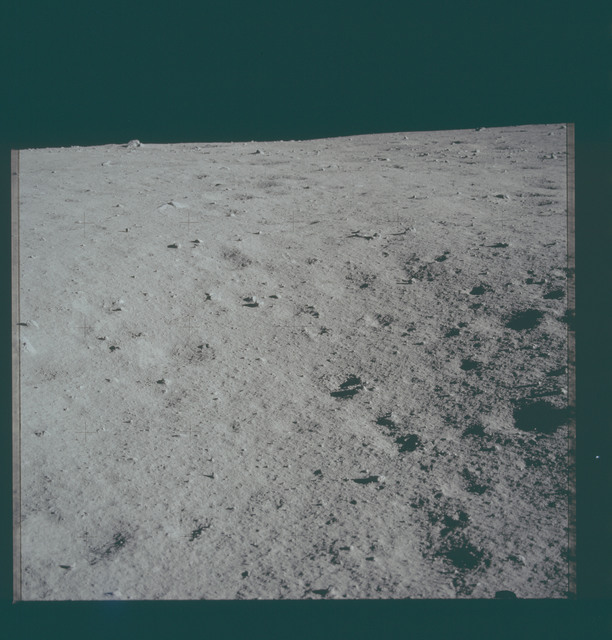 AS11-40-5909 - Apollo 11 - Apollo 11 Mission image -  Lunar surface and horizon with shallow craters visible