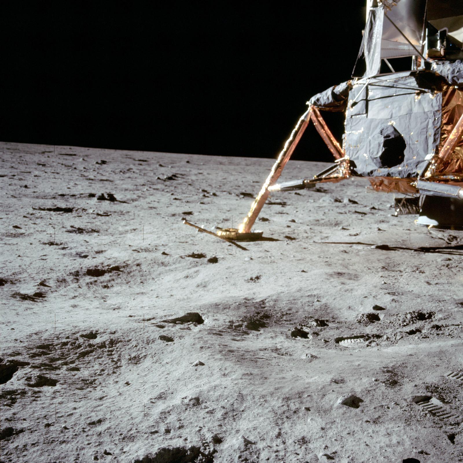 AS11-40-5914 - Apollo 11 - Apollo 11 Mission image -  Lunar surface and horizon with Lunar Module visible