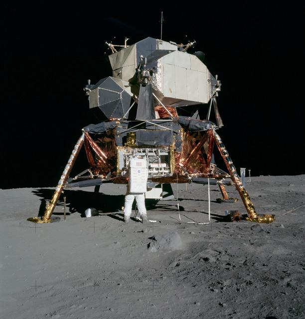AS11-40-5927 - Apollo 11 - Apollo 11 Mission image - Astronaut Edwin Aldrin unpacks experiments from the Lunar Module