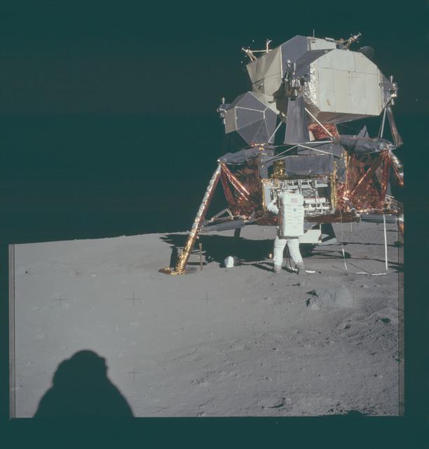AS11-40-5928 - Apollo 11 - Apollo 11 Mission image - Astronaut Edwin Aldrin unpacks experiments from the Lunar Module