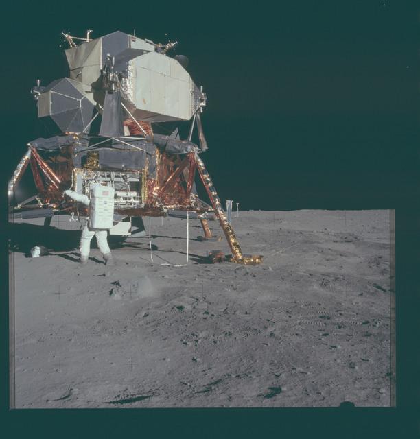 AS11-40-5929 - Apollo 11 - Apollo 11 Mission image - Astronaut Edwin Aldrin unpacks experiments from the Lunar Module