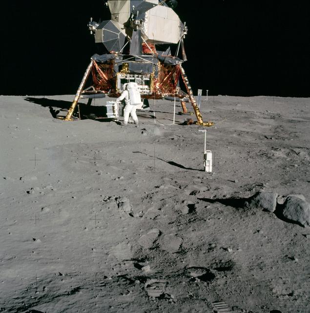 AS11-40-5931 - Apollo 11 - Apollo 11 Mission image - Astronaut Edwin Aldrin unpacks experiments from the Lunar Module