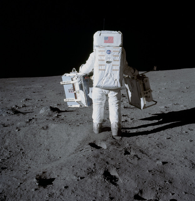 AS11-40-5942 - Apollo 11 - Apollo 11 Mission image - Astronaut Edwin Aldrin carries experiments to deployment area