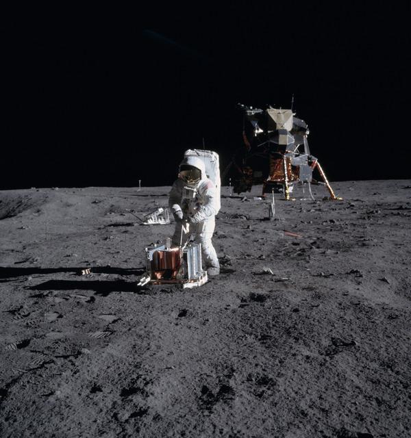 AS11-40-5946 - Apollo 11 - Apollo 11 Mission image - Astronaut Edwin Aldrin deploys the PSEP