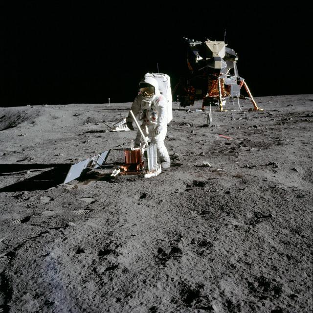 AS11-40-5947 - Apollo 11 - Apollo 11 Mission image - Astronaut Edwin Aldrin deploys the PSEP