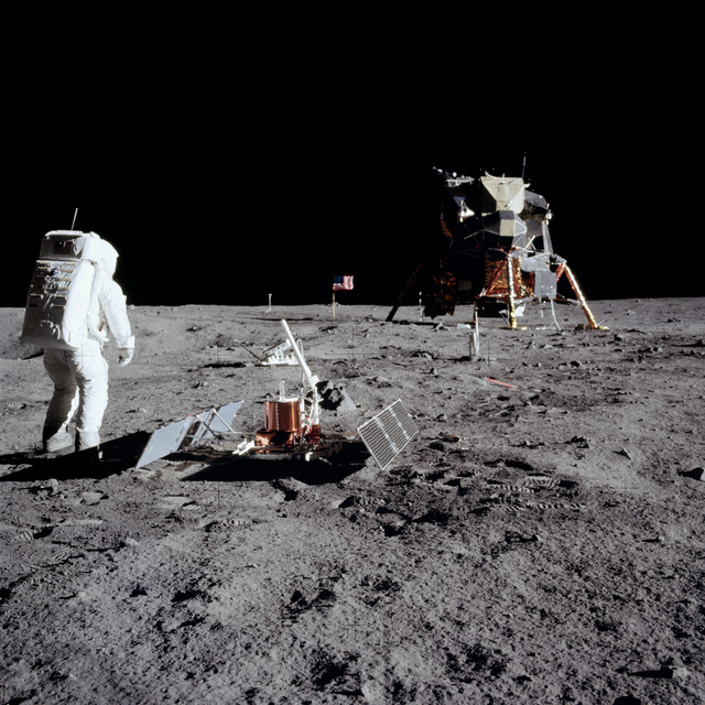 AS11-40-5948 - Apollo 11 - Apollo 11 Mission image - Astronaut Edwin Aldrin sets up the PSEP