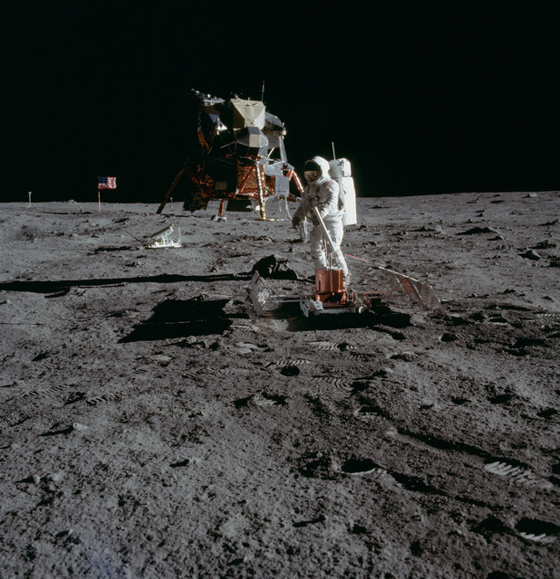AS11-40-5949 - Apollo 11 - Apollo 11 Mission image - Astronaut Edwin Aldrin sets up the PSEP