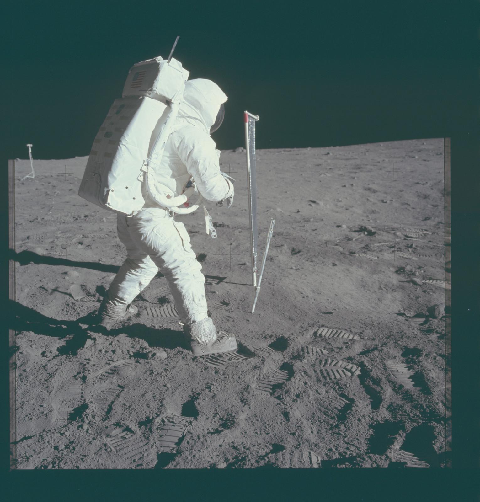 AS11-40-5963 - Apollo 11 - Apollo 11 Mission image - Astronaut Edwin Aldrin takes a core-tube sample