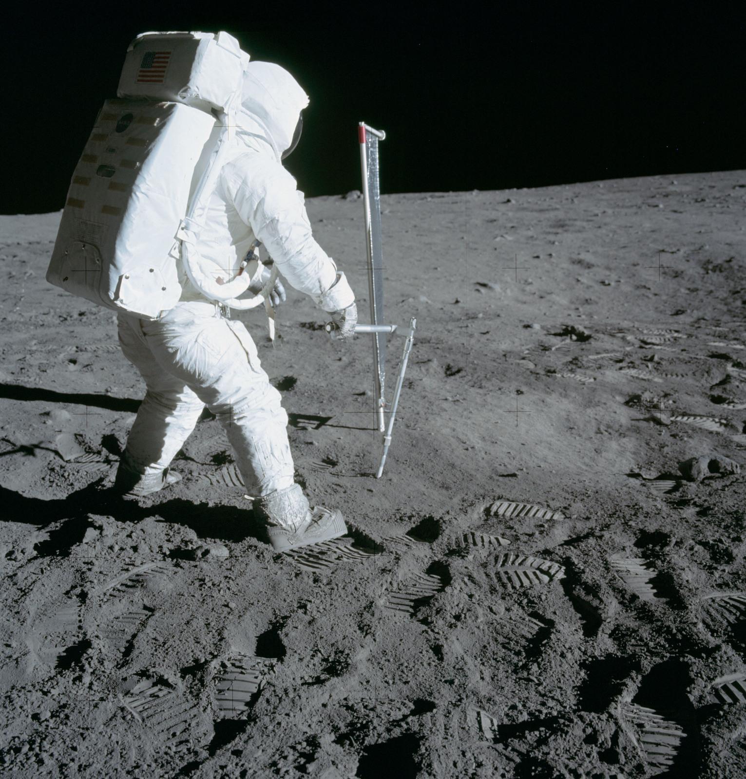 AS11-40-5964 - Apollo 11 - Apollo 11 Mission image - Astronaut Edwin Aldrin takes a core-tube sample