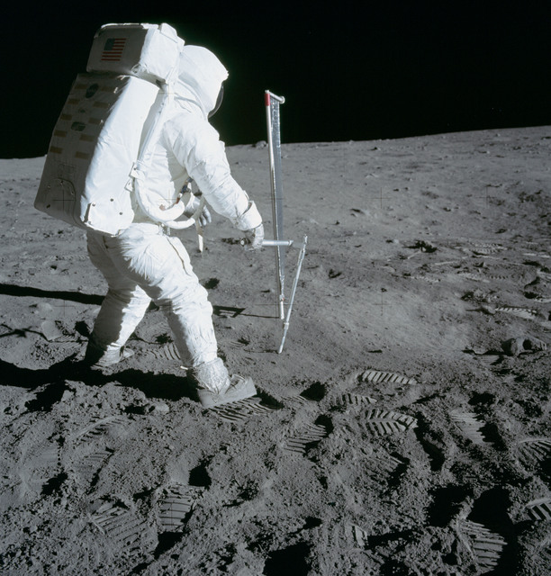 AS11-40-5964 - Apollo 11 - Apollo 11 Mission image - Astronaut Edwin Aldrin takes a core-tube sample