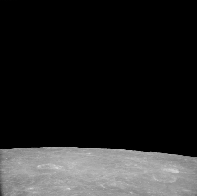 AS11-41-5999 - Apollo 11 - Apollo 11 Mission image - View of Moon, Craters 204 and 202
