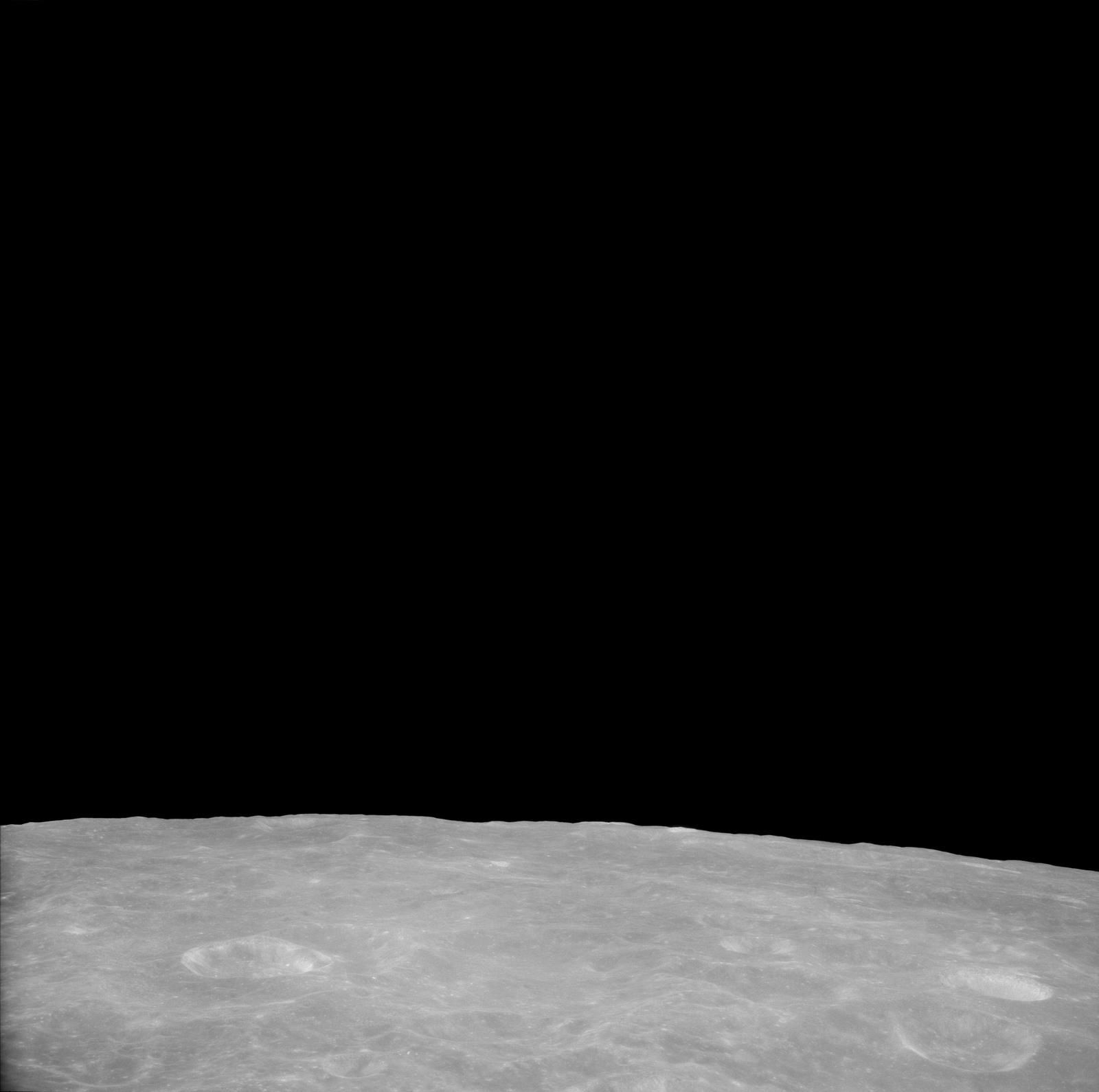 AS11-41-6000 - Apollo 11 - Apollo 11 Mission image - View of Moon, Crater 202