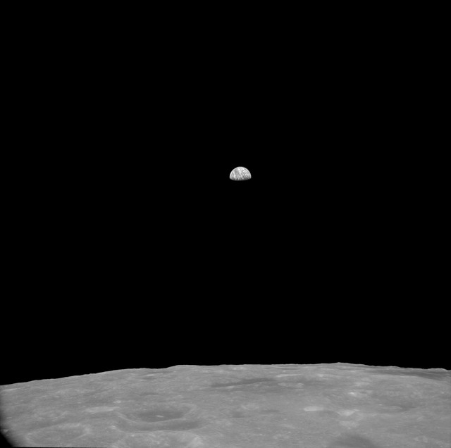 AS11-41-6038 - Apollo 11 - Apollo 11 Mission image - View of Moon, Craters Gilbert M and Schubert F