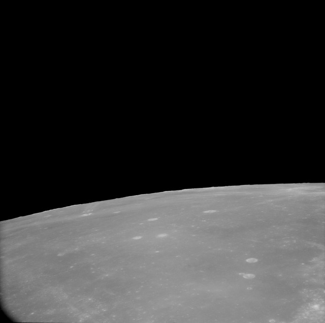 AS11-41-6063 - Apollo 11 - Apollo 11 Mission image - View of Moon, Mare Fecunditatis and TO 67