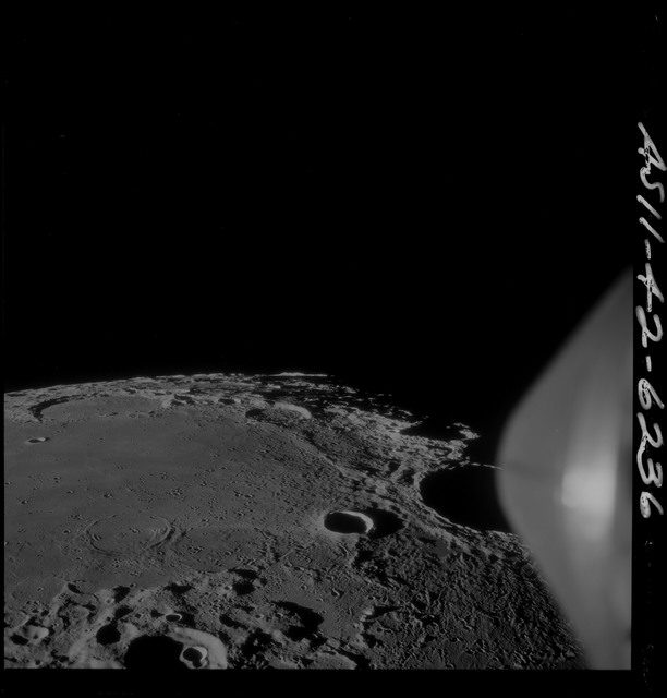 AS11-42-6236 - Apollo 11 - Apollo 11 Mission image - Craters Theophilus, Madler, Daguerre