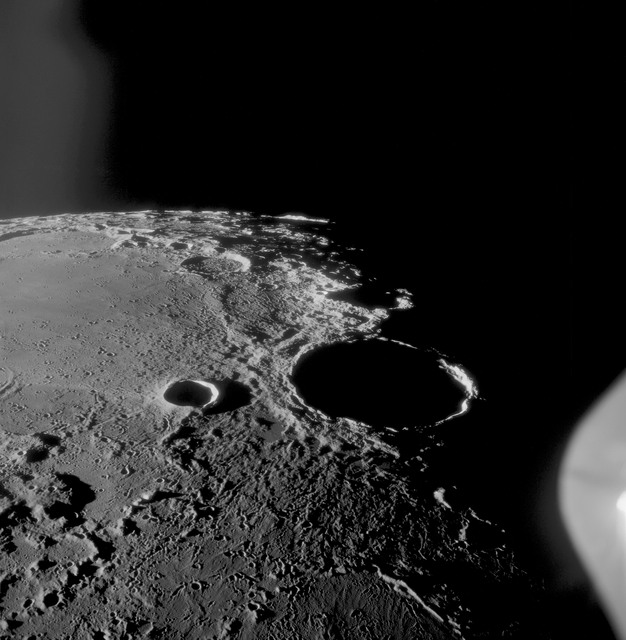 AS11-42-6237 - Apollo 11 - Apollo 11 Mission image - Craters Theophilus, Madler, Daguerre