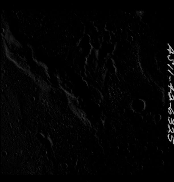 AS11-42-6325 - Apollo 11 - Apollo 11 Mission image - Dark view of moon, not plotted.