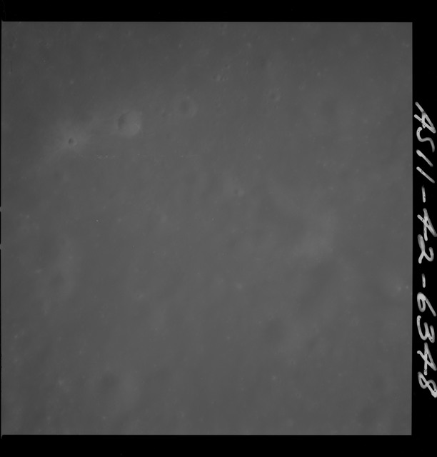 AS11-42-6348 - Apollo 11 - Apollo 11 Mission image - Unnamed Craters North of Crater 303