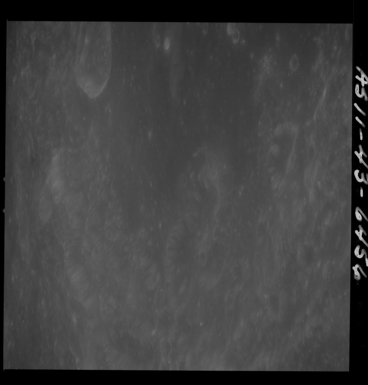 AS11-43-6456 - Apollo 11 - Apollo 11 Mission image - Moon, Crater Neper, Crater Neper G and Neper Q