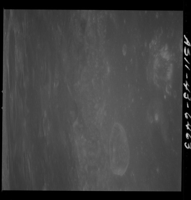 AS11-43-6463 - Apollo 11 - Apollo 11 Mission image - Moon, Crater Neper, Neper G and partial TO 16