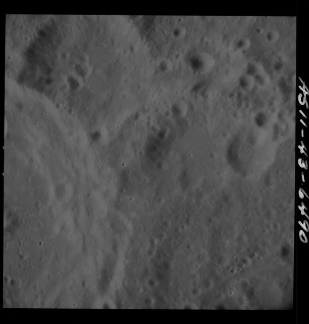 AS11-43-6490 - Apollo 11 - Apollo 11 Mission image - Moon, Between Craters 225 and 303
