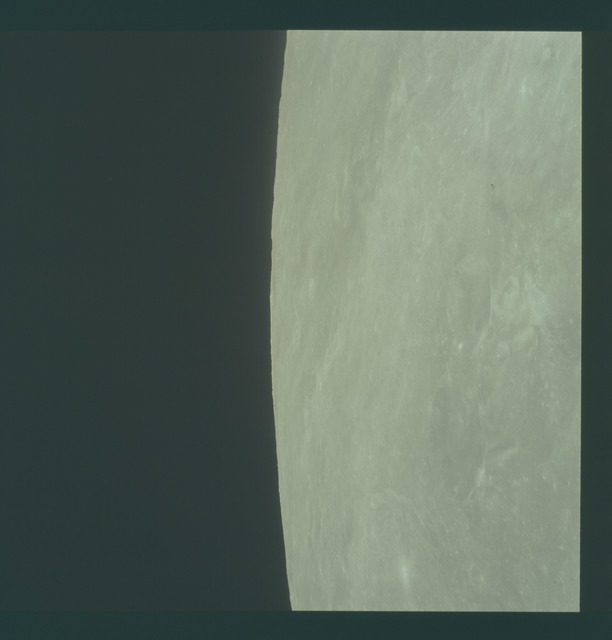 AS11-44-6544 - Apollo 11 - Apollo 11 Mission image - View of moon limb, Crater 205, 221, TO 46 and 47