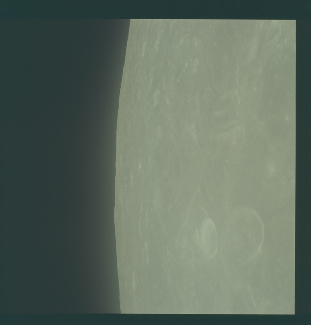 AS11-44-6546 - Apollo 11 - Apollo 11 Mission image - View of moon limb, Crater 201 complex, TO 53