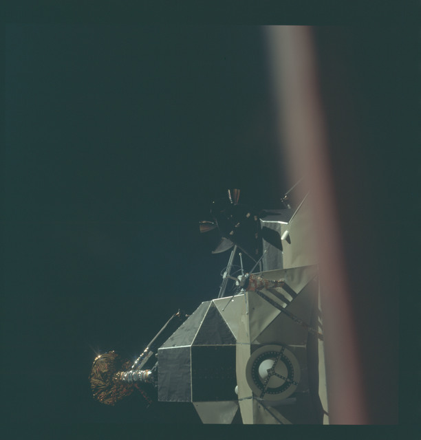 AS11-44-6565 - Apollo 11 - Apollo 11 Mission image - View of Lunar Module separation from the Command Module