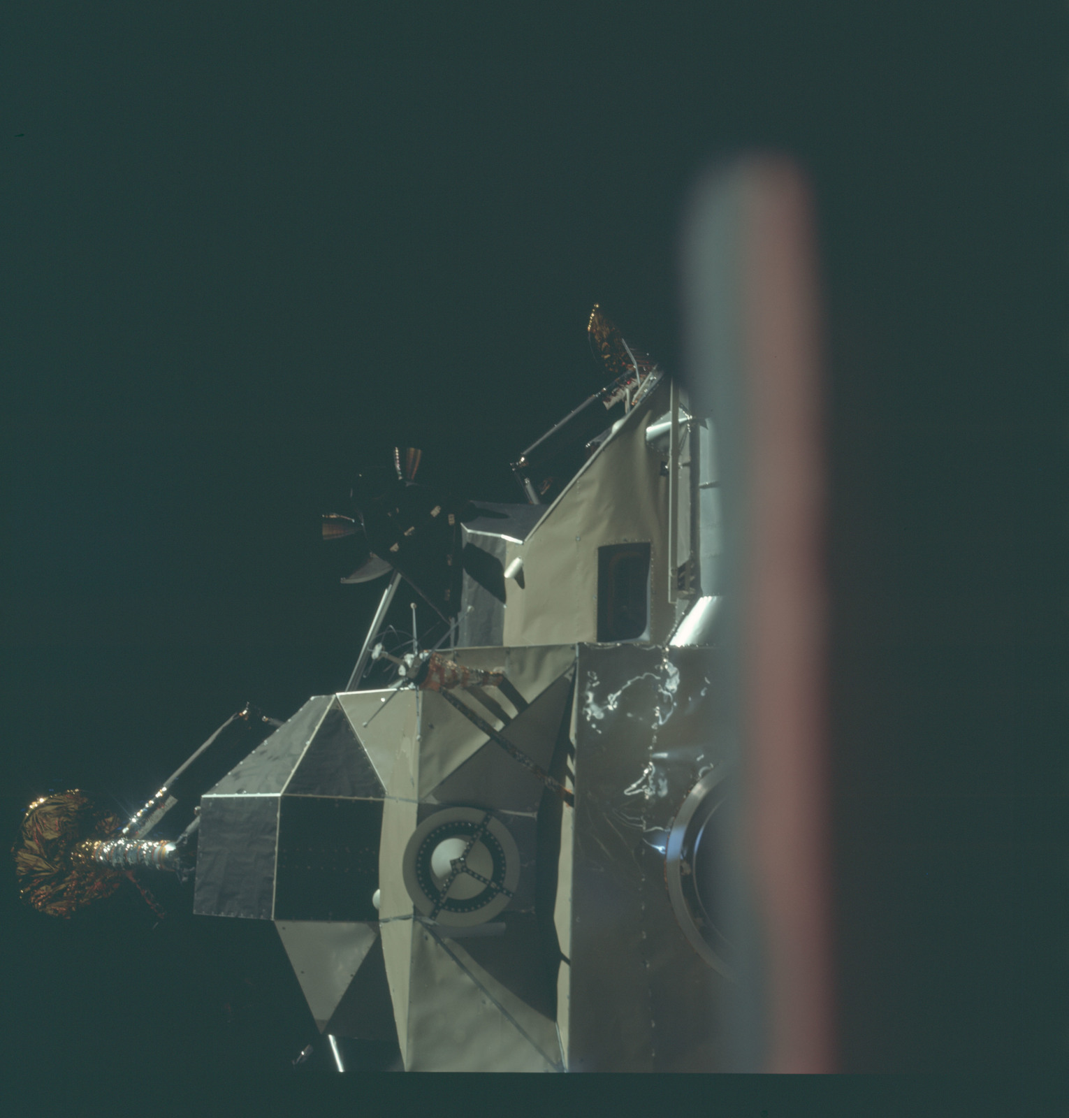 AS11-44-6566 - Apollo 11 - Apollo 11 Mission image - View of Lunar Module separation from the Command Module