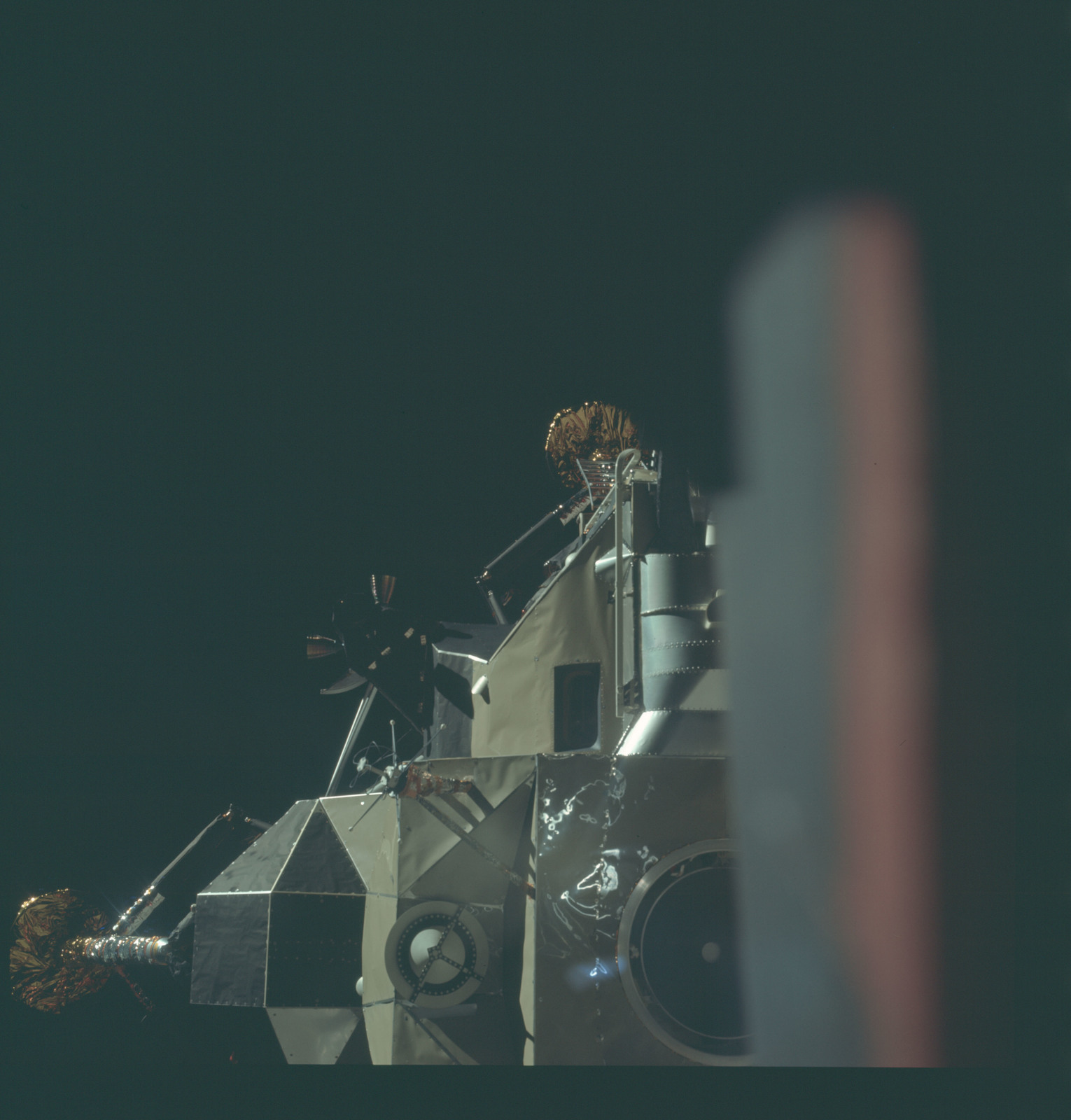 AS11-44-6567 - Apollo 11 - Apollo 11 Mission image - View of Lunar Module separation from the Command Module