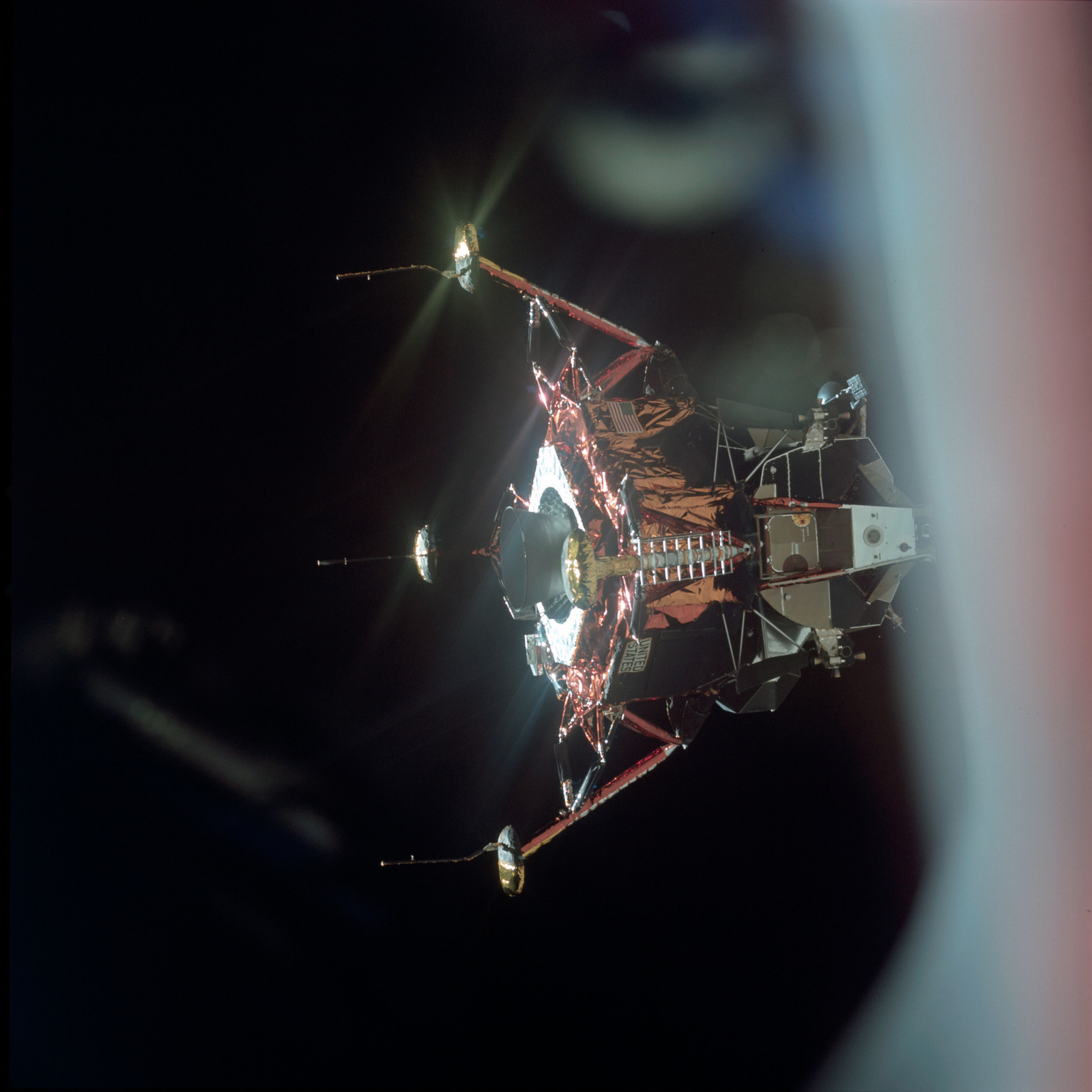 AS11-44-6574 - Apollo 11 - Apollo 11 Mission image - View of Lunar Module separation from the Command Module
