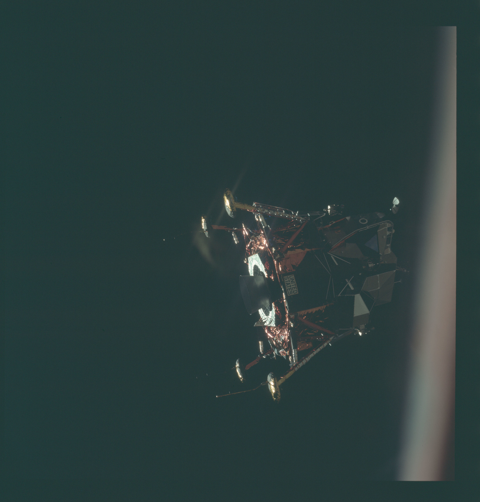 AS11-44-6578 - Apollo 11 - Apollo 11 Mission image - View of Lunar Module separation from the Command Module
